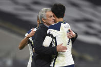 Tottenham's manager Jose Mourinho, left, cheers Tottenham's Son Heung-min during the English Premier League soccer match between Tottenham Hotspur and Manchester City at Tottenham Hotspur Stadium in London, England, Saturday, Nov. 21, 2020. (Neil Hall/Pool via AP)