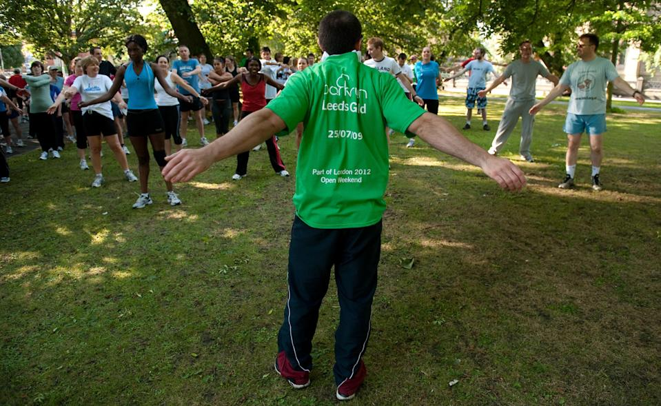 Participants stretch ahead of the 5km parkrun around Hyde Park in Leeds (PA Archive)