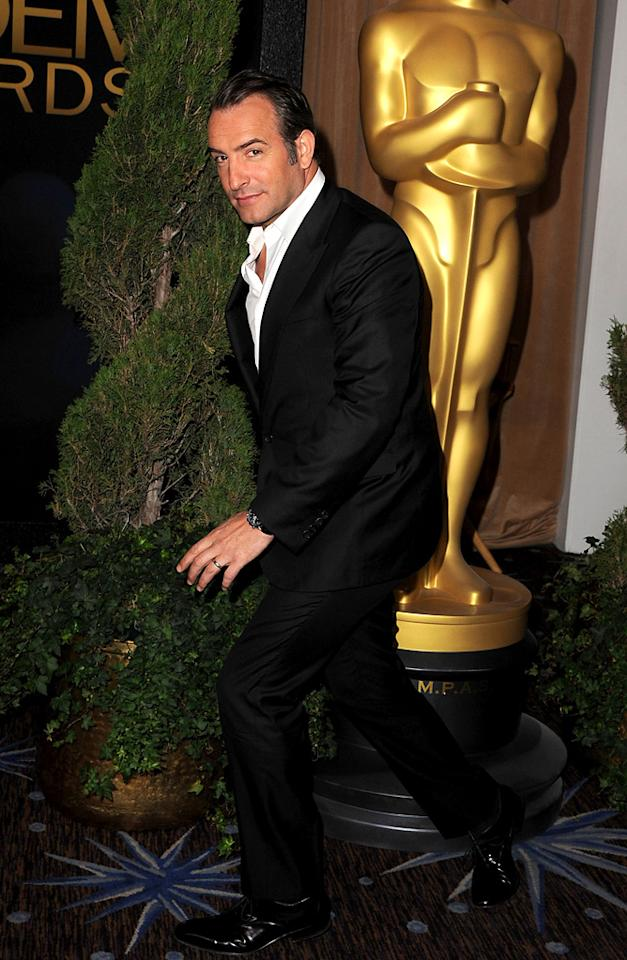 """The Artist's"" Jean Dujardin -- who will undoubtedly give Clooney a run for his money come Oscar Sunday -- struck a Heisman-like pose upon arriving at the Beverly Hilton Hotel."