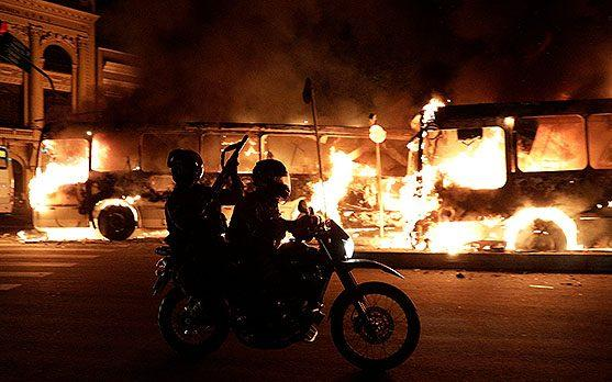 Buses burn during clashes between demonstrators and riot police in a protest against President Michel Temer's proposed reform of Brazil's social security system, in Rio de Janeiro - Credit: Ricardo Moraes/REUTERS