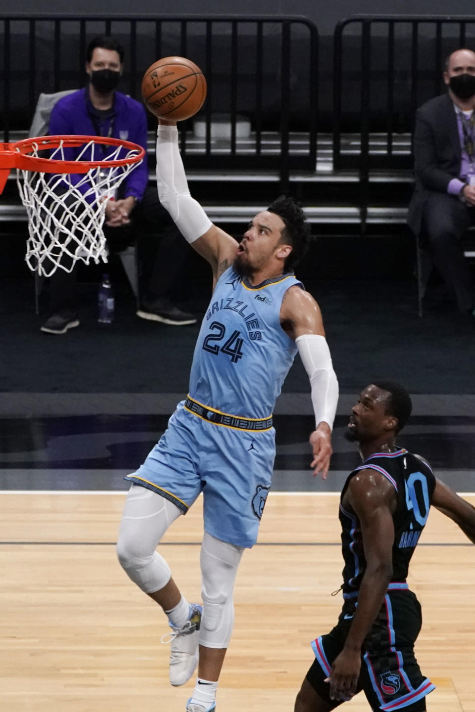 Memphis Grizzlies guard Dillon Brooks, left, goes to the basket past Sacramento Kings forward Harrison Barnes, right, during the first half of an NBA basketball game in Sacramento, Calif., Sunday, Feb. 14, 2021. (AP Photo/Rich Pedroncelli)