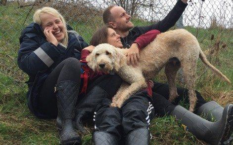 Cooper the Labradoodle was put on the wrong flight by WestJet staff, then lost at the airport. Owner Terri Pittman is centre - CBC