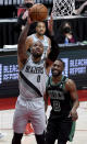 Portland Trail Blazers guard Damian Lillard drives to the basket past Boston Celtics guard Kemba Walker, right, during the second half of an NBA basketball game in Portland, Ore., Tuesday, April 13, 2021. (AP Photo/Steve Dykes)