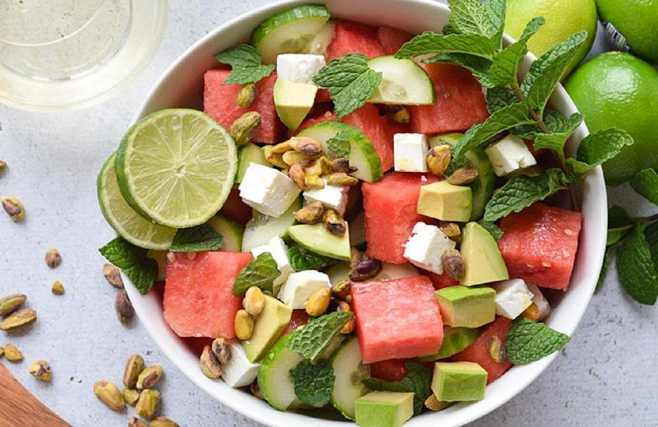 """<p>Watermelon, cucumber and mint honestly may be some of the most refreshing ingredients on Earth, and this salad just so happens to use all three of them along with briny feta. Serve beside spicy summer dishes to balance out the heat.</p> <p><a href=""""https://www.thedailymeal.com/recipes/watermelon-and-cucumber-salad-recipe-0?referrer=yahoo&category=beauty_food&include_utm=1&utm_medium=referral&utm_source=yahoo&utm_campaign=feed"""" rel=""""nofollow noopener"""" target=""""_blank"""" data-ylk=""""slk:For the Watermelon and Cucumber Salad recipe, click here."""" class=""""link rapid-noclick-resp"""">For the Watermelon and Cucumber Salad recipe, click here.</a></p>"""