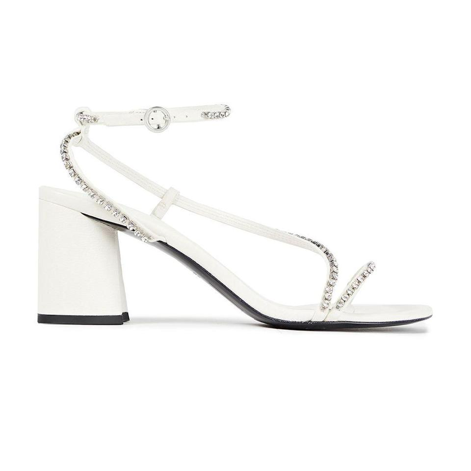 """<p><strong>3.1 PHILLIP LIM</strong></p><p>theoutnet.com</p><p><strong>$247.00</strong></p><p><a href=""""https://go.redirectingat.com?id=74968X1596630&url=https%3A%2F%2Fwww.theoutnet.com%2Fen-us%2Fshop%2Fproduct%2F3-1-phillip-lim%2Fsandals%2Fmid-heel-sandals%2Fdrum-crystal-embellished-leather-sandals%2F10163292708603877&sref=https%3A%2F%2Fwww.cosmopolitan.com%2Fstyle-beauty%2Ffashion%2Fg35702755%2Fthe-outnet-semi-annual-sale%2F"""" rel=""""nofollow noopener"""" target=""""_blank"""" data-ylk=""""slk:Shop Now"""" class=""""link rapid-noclick-resp"""">Shop Now</a></p><p><strong><del>$495</del> $247 (50% off)</strong></p>"""