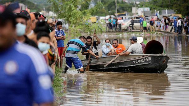 PHOTO: People board a boat to get to their flooded house after the passage of Storm Eta, in Pimienta, Honduras, Nov. 5, 2020. (Jorge Cabrera/Reuters)