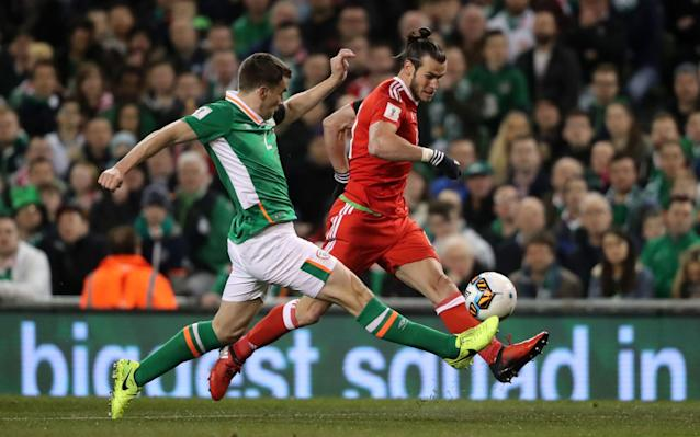<span>Earlier Ireland's Seamus Coleman tackles Wales' Gareth Bale during the World Cup qualifier</span> <span>Credit: Niall Carson/PA Wire </span>