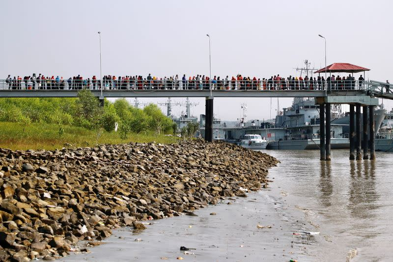 Rohingyas board a ship as they are moved to Bhasan Char island in Chattogram, Bangladesh