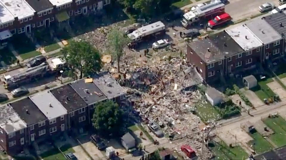 The scene of an explosion in Baltimore on Monday, 10 August, which leveled several homes: WJLA-TV via AP
