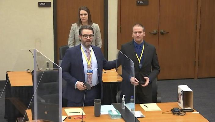 In this image taken from video, defense attorney Eric Nelson, left, defendant and former Minneapolis police officer Derek Chauvin, right, and Nelson's assistant Amy Voss, back, introduce themselves to potential jurors on Tuesday, March 23, 2021, as Hennepin County Judge Peter Cahill presides over jury selection in the trial of Chauvin at the Hennepin County Courthouse in Minneapolis. (Court TV, via AP, Pool)