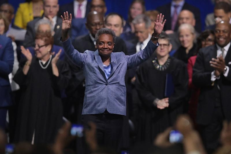"Lori Lightfoot celebrates after being sworn in as mayor of Chicago, telling her city to ""get ready, because reform is here"""