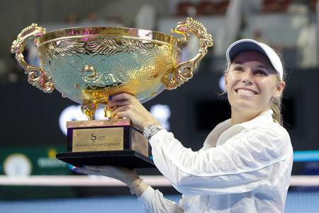 Tennis - China Open - Women's Singles - Final - National Tennis Center, Beijing, China - October 7, 2018. Caroline Wozniacki of Denmark celebrates with the trophy after winning the match against Anastasija Sevastova of Latvia. REUTERS/Jason Lee