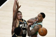 Boston Celtics guard Jeff Teague (55) passes as Atlanta Hawks guard Trae Young (11) defends In the first half of an NBA basketball game Wednesday, Feb. 24, 2021, in Atlanta. (AP Photo/John Bazemore)