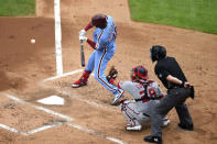Philadelphia Phillies' Didi Gregorius, left, hits a two-run RBI-single off Washington Nationals' Anibal Sanchez during the first inning of a baseball game, Thursday, Sept. 3, 2020, in Philadelphia. (AP Photo/Derik Hamilton)