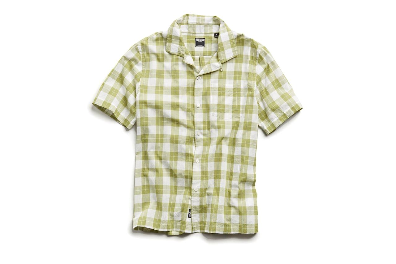 "$158, Todd Snyder. <a href=""https://www.toddsnyder.com/collections/new-arrivals/products/vintage-plaid-camp-collar-short-sleeve-shirt-green"">Get it now!</a>"