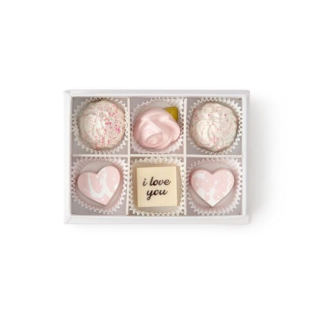 "<h2>Maggie Louise Love Is Sweet Chocolate Box</h2><br>This six-piece dainty chocolate gift box is the definition of simple and sweet. Inside you'll find two milk chocolates with strawberry crisp, two dark chocolates with salted caramel, one white chocolate with strawberry crisp, and one plain white chocolate treat. <br><br><em>Shop</em> <strong><em><a href=""http://uncommongoods.com"" rel=""nofollow noopener"" target=""_blank"" data-ylk=""slk:Uncommon Goods"" class=""link rapid-noclick-resp"">Uncommon Goods</a></em></strong><br><br><strong>Maggie Louise Callahan</strong> Love Is Sweet Chocolate Box, $, available at <a href=""https://go.skimresources.com/?id=30283X879131&url=https%3A%2F%2Fwww.uncommongoods.com%2Fproduct%2Flove-is-sweet-chocolate-box"" rel=""nofollow noopener"" target=""_blank"" data-ylk=""slk:Uncommon Goods"" class=""link rapid-noclick-resp"">Uncommon Goods</a>"