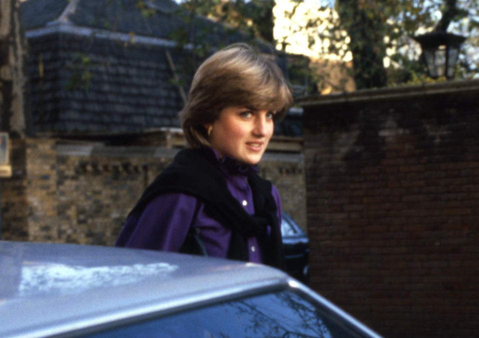 """FILE - In this file photo dated Nov. 1980, Lady Diana Spencer, faces the media near her flat in the Earls Court district of London. For someone who began her life in the spotlight as """"Shy Di,"""" Princess Diana became an unlikely, revolutionary during her years in the House of Windsor. She helped modernize the monarchy by making it more personal, changing the way the royal family related to people. By interacting more intimately with the public -- kneeling to the level of children, sitting on edge of a patient's hospital bed, writing personal notes to her fans -- she set an example that has been followed by other royals as the monarchy worked to become more human and remain relevant in the 21st century. (AP Photo, File)"""