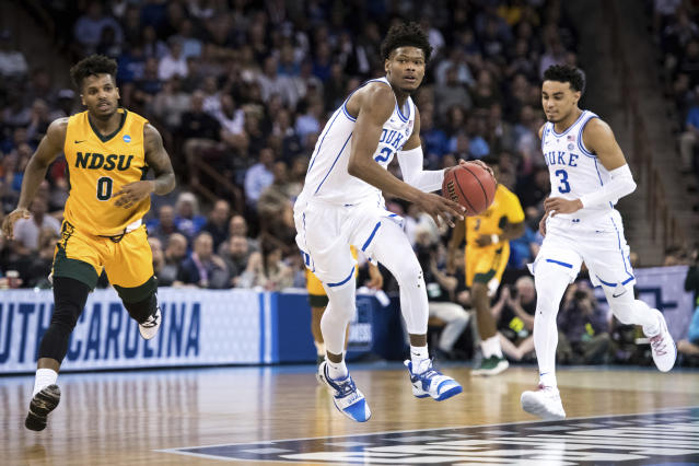 Duke forward Cam Reddish (2) dribbles the ball against North Dakota State guard Vinnie Shahid (0) during the first half of a first-round game in the NCAA men's college basketball tournament Friday, March 22, 2019, in Columbia, S.C. Duke defeated North Dakota State 85-62. (AP Photo/Sean Rayford)