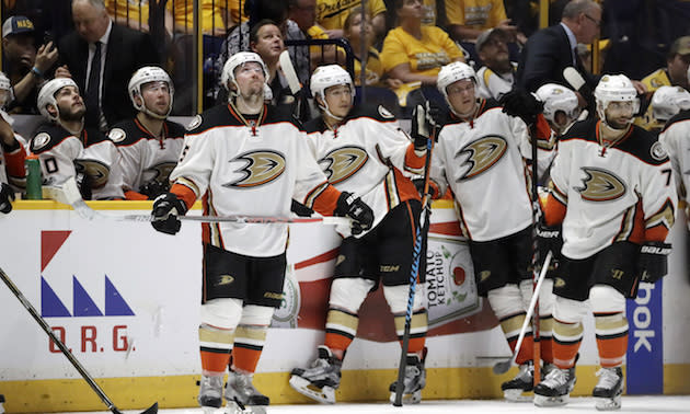 "Anaheim Duck players watch a replay during the second period against the <a class=""link rapid-noclick-resp"" href=""/nhl/teams/nas/"" data-ylk=""slk:Nashville Predators"">Nashville Predators</a> in Game 3 of the Western Conference final in the NHL hockey Stanley Cup playoffs Tuesday, May 16, 2017, in Nashville, Tenn. (AP Photo/Mark Humphrey)"