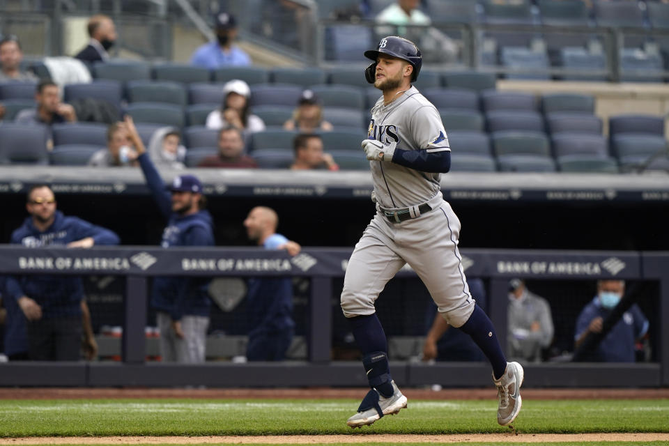 Tampa Bay Rays designated hitter Austin Meadows (17) trots home after hitting a two-run home run in the fourth inning of a baseball game against the New York Yankees, Thursday, June 3, 2021, at Yankee Stadium in New York. (AP Photo/Kathy Willens)