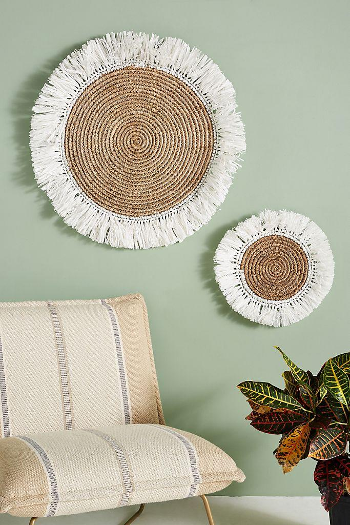 """<h3><a href=""""https://www.anthropologie.com/decor-art"""" rel=""""nofollow noopener"""" target=""""_blank"""" data-ylk=""""slk:Anthropologie"""" class=""""link rapid-noclick-resp"""">Anthropologie</a></h3><br>We love anything and everything from Anthropologie's home & furniture section, and its collection of wall art is no exception. They've got plenty of bohemian-cool, handcrafted decor items including a great selection of woven basket situations that are made to be mounted on the wall.<br><br><strong>Anthropologie</strong> Fringed Basket Wall Art, $, available at <a href=""""https://go.skimresources.com/?id=30283X879131&url=https%3A%2F%2Fwww.anthropologie.com%2Fshop%2Ffringed-basket-wall-art2"""" rel=""""nofollow noopener"""" target=""""_blank"""" data-ylk=""""slk:Anthropologie"""" class=""""link rapid-noclick-resp"""">Anthropologie</a>"""