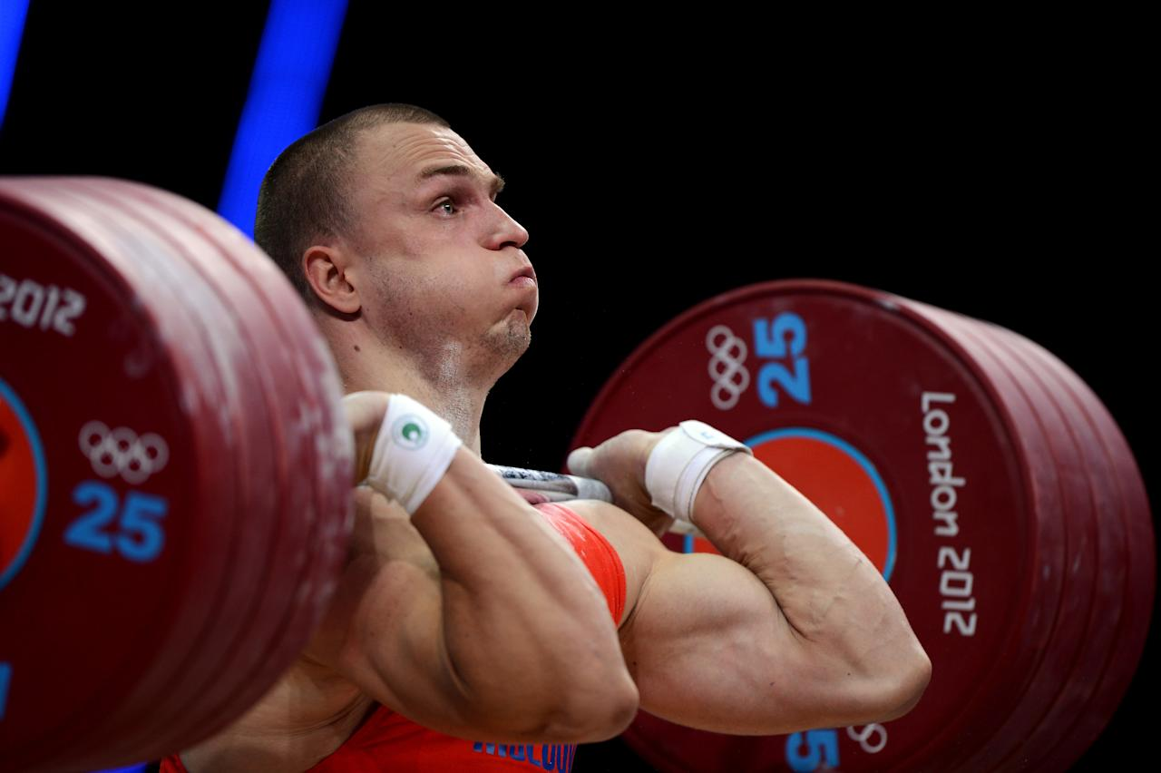 LONDON, ENGLAND - AUGUST 04:  Bronze medallist Anatoli Ciricu of Moldova competes in the Men's 94kg Weightlifting final on Day 8 of the London 2012 Olympic Games at ExCeL on August 4, 2012 in London, England.  (Photo by Michael Regan/Getty Images)