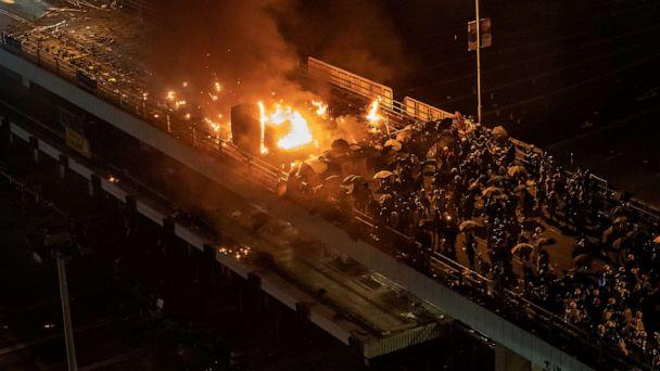 PHOTO: A police vehicle is set on fire as demonstrators throw fire bombs on a bridge at The Hong Kong Polytechnic University, Nov. 17, 2019, in Hong Kong. (Anthony Kwan/Getty Images)