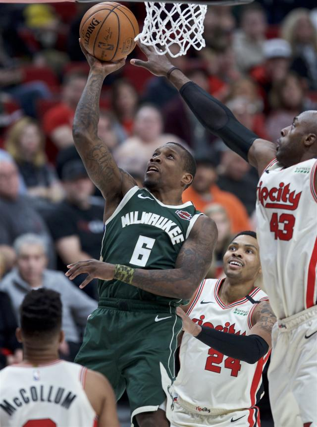 Milwaukee Bucks guard Eric Bledsoe, left, shoots next to Portland Trail Blazers forward Anthony Tolliver (43) during the second half of an NBA basketball game in Portland, Ore., Saturday, Jan. 11, 2020. (AP Photo/Craig Mitchelldyer)