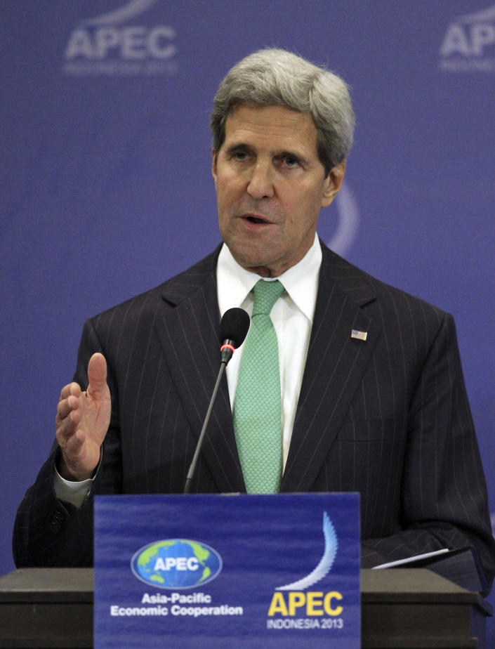 """U.S. Secretary of State John Kerry speaks during a press conference at the Asia-Pacific Economic Cooperation (APEC) summit in Bali, Indonesia, Saturday, Oct. 5, 2013. Kerry on Saturday urged Congress to end the partial government shutdown and think """"long and hard"""" about the message U.S. sends the world when """"we can't get our own act together."""" (AP Photo/Wong Maye-E)"""