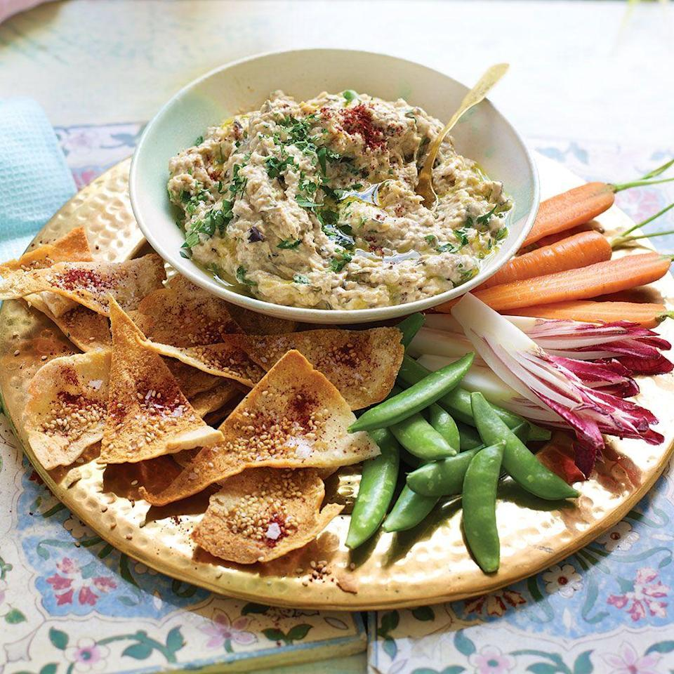 """<p>This smoky aubergine dip is simple to make and incredibly moreish – it's ideal for preparing ahead, too.</p><p><strong>Recipe: <a href=""""https://www.goodhousekeeping.com/uk/food/recipes/a570596/aubergine-dip-recipe/"""" rel=""""nofollow noopener"""" target=""""_blank"""" data-ylk=""""slk:Mutabal with Sesame Pitta Crisps"""" class=""""link rapid-noclick-resp"""">Mutabal with Sesame Pitta Crisps</a></strong></p>"""