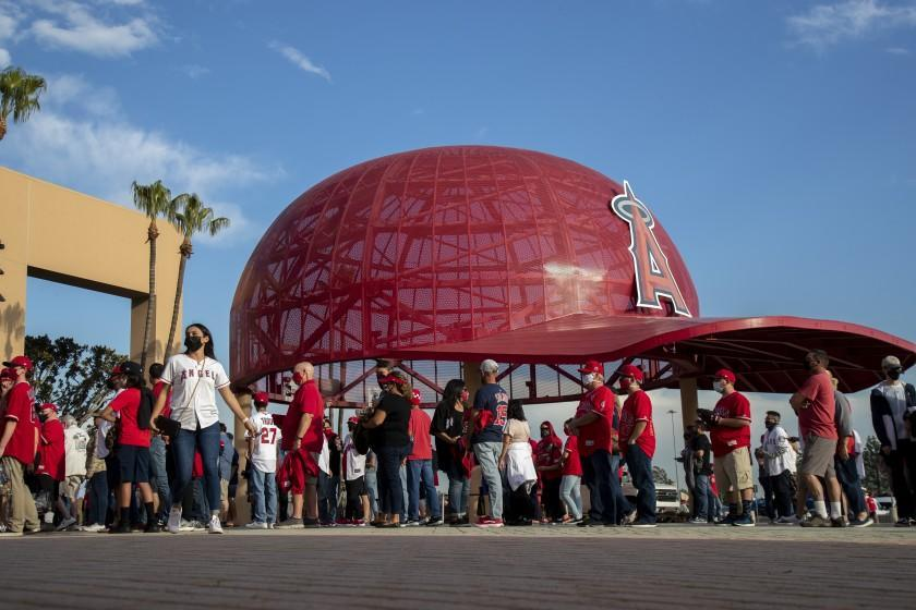 ANAHEIM, CA - APRIL 1, 2021: Fans line up to enter Angel Stadium for the Angels home opener.