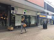 A woman passes by the Hanley Economic Building Society branch in Stoke-on-Trent