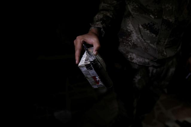 <p>A member of the Iraqi Army's 9th Armoured Division holds a self-made bomb found inside a compound used as a prison by Islamic State militants in the 17 Tamuz (July 17) district, in western Mosul, Iraq, June 6, 2017. (Alkis Konstantinidis/Reuters) </p>