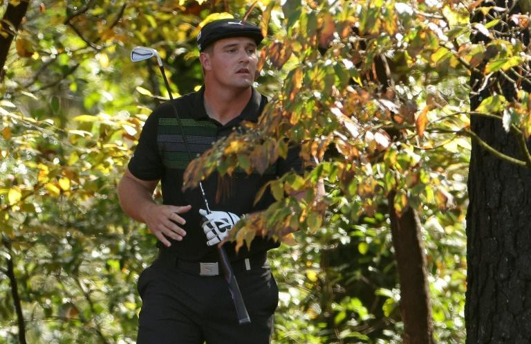 US Open champion Bryson DeChambeau went into the trees on two of his first four holes on the way to a 2-under effort in the first round of the Masters