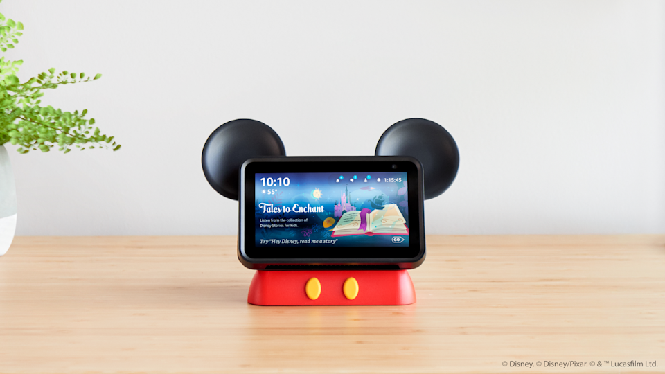 """Amazon and Disney partnered to create """"Hey, Disney!"""" the first custom-branded voice assistant using Alexa-technology, which will be free to use at Disney Resort hotels and available for purchase at home. A Mickey-inspired OtterBox Den Series stand for the Echo Show 5 will also be sold."""