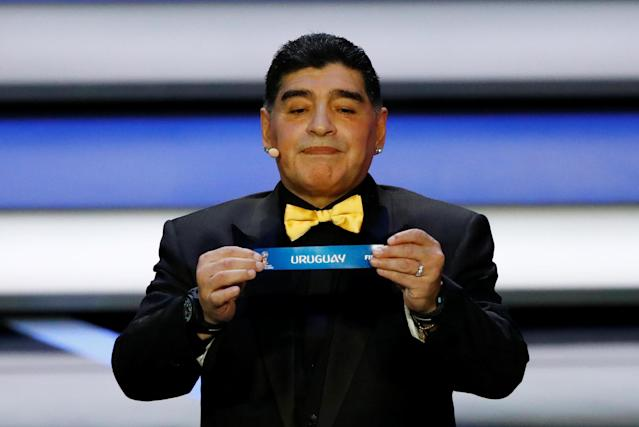 Soccer Football - 2018 FIFA World Cup Draw - State Kremlin Palace, Moscow, Russia - December 1, 2017 Diego Maradona pulls out Uruguay during the draw REUTERS/Kai Pfaffenbach