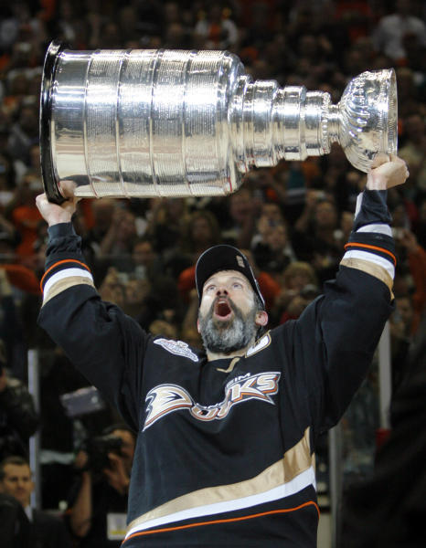 FILE - In this June 6, 2007 file photo, Anaheim Ducks captain Scott Niedermayer holds up the Stanley Cup after the Ducks defeated the Ottawa Senators, 6-2, in Game 5 of the Stanley Cup hockey finals in Anaheim, Calif. Niedermayer and Chris Chelios, along with forward Brendan Shanahan have been picked for the Hockey Hall of Fame. (AP Photo/Mark Avery, File)