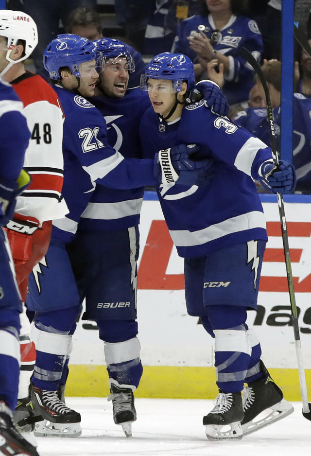 Tampa Bay Lightning center Yanni Gourde (37) celebrates with center Brayden Point (21) after scoring against the Carolina Hurricanes during the third period of an NHL hockey game Tuesday, Oct. 16, 2018, in Tampa, Fla. The Lightning won the game 4-2. (AP Photo/Chris O'Meara)
