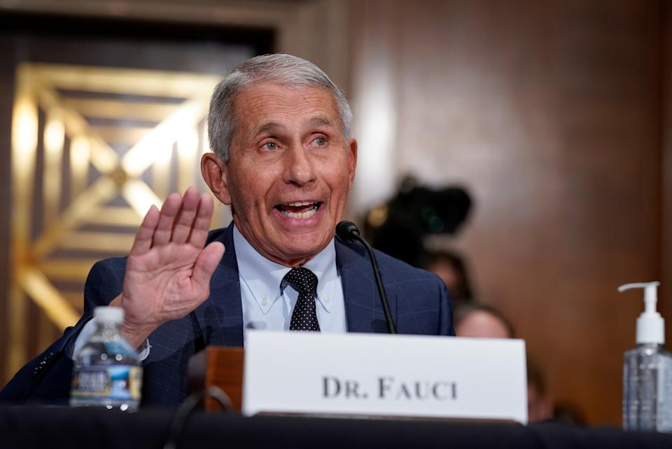 Top infectious disease expert Dr. Anthony Fauci responds to accusations by Sen. Rand Paul (R-KY) as he testifies before the Senate Health, Education, Labor, and Pensions Committee on Capitol hill in Washington, D.C., U.S., July 20, 2021.  J. Scott Applewhite/Pool via REUTERS