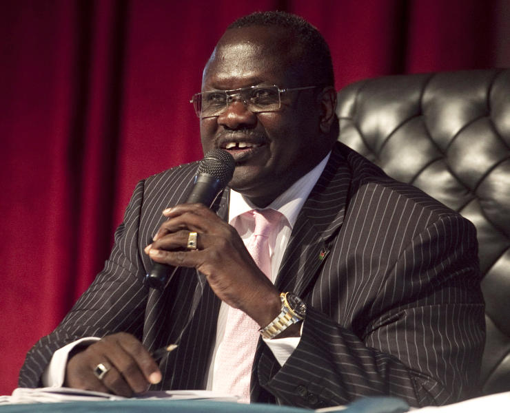 FILE- In this Oct. 13 2010 file photo, Riek Machar, former Vice President of the Government of South Sudan, presides over an all-southern-parties meeting in Juba, Sudan, Sporadic gunfire rang out early Monday, Dec. 16, 2013 in the South Sudan capital, Juba, in what a senior military official said were clashes between factions of the country's military. There has been political tension in the world's youngest nation since South Sudan President Salva Kiir fired Machar as his deputy in July. (AP Photo/Pete Muller, File)