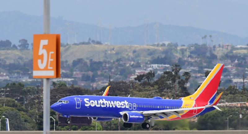 A Southwest Airlines airplane comes in for a landing at Los Angeles International Airport on May 12, 2020 in Los Angeles, California. - The airline and travel industries have been devasted by the coronavirus pandemic as Stay-at-Home orders in Los Angeles, due to end in mid-May, have been extended to July. (Photo by Frederic J. BROWN / AFP) (Photo by FREDERIC J. BROWN/AFP via Getty Images)