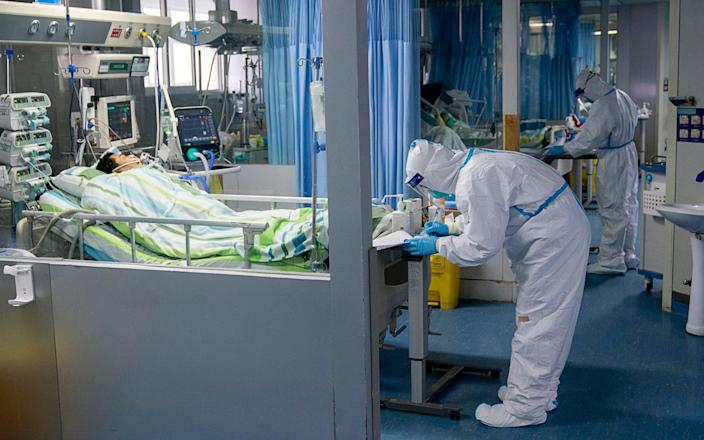 A medical worker attends to a patient in the intensive care unit at Zhongnan Hospital of Wuhan University - Xinhua