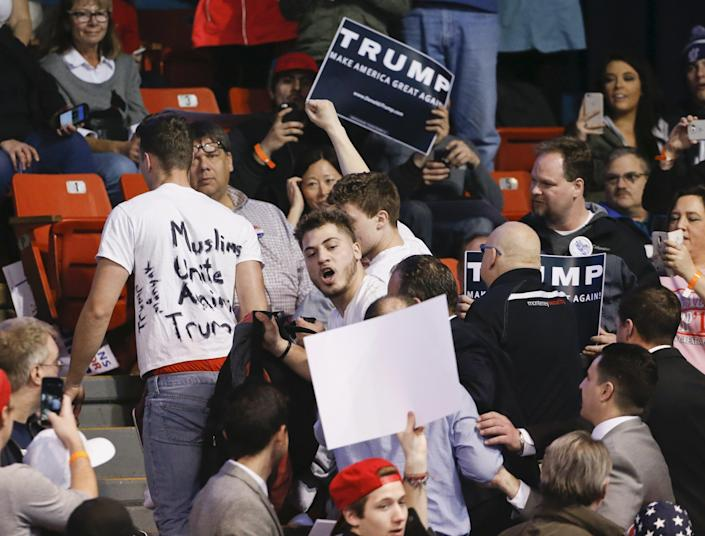 Protesters are escorted out of UIC Pavilion before Republican U.S. presidential candidate Donald Trump's rally at the University of Illinois at Chicago March 11, 2016. REUTERS/Kamil Krzaczynski