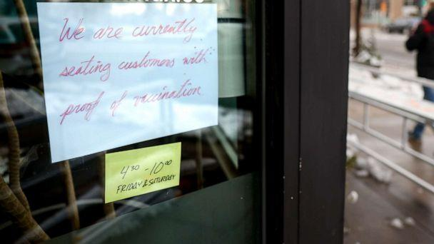 PHOTO: A sign in the window at Bar Max reads, We are currently seating customers with proof of vaccination, on April 16, 2021, in Denver. (Michael Ciaglo/Getty Images, FILE)