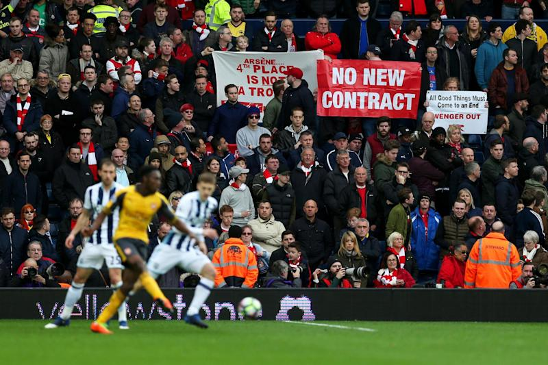 Unrest | Arsenal fans display banners during the Premier League match at West Brom: Alex Morton/Getty Images