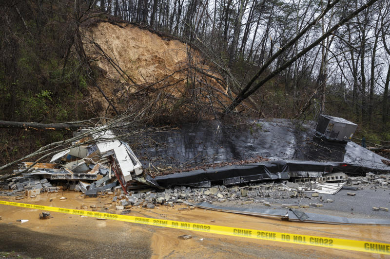 The remains of a Subway restaurant on Signal Mountain Road are seen after an overnight mudslide destroyed the business on Saturday, Feb. 23, 2019, in Chattanooga, Tenn. Subway manager Robbie Anderson said that the restaurant had closed at about 2:00 on Friday for safety after two trees fell from the hillside. (Doug Strickland/Chattanooga Times Free Press via AP)