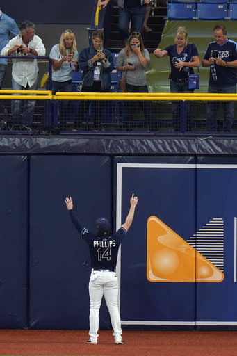 Tampa Bay Rays' Brett Phillips celebrates with family members after the Rays eliminated the Toronto Blue Jays during Game 2 of an American League wild-card baseball series Wednesday, Sept. 30, 2020, in St. Petersburg, Fla. (AP Photo/Chris O'Meara)