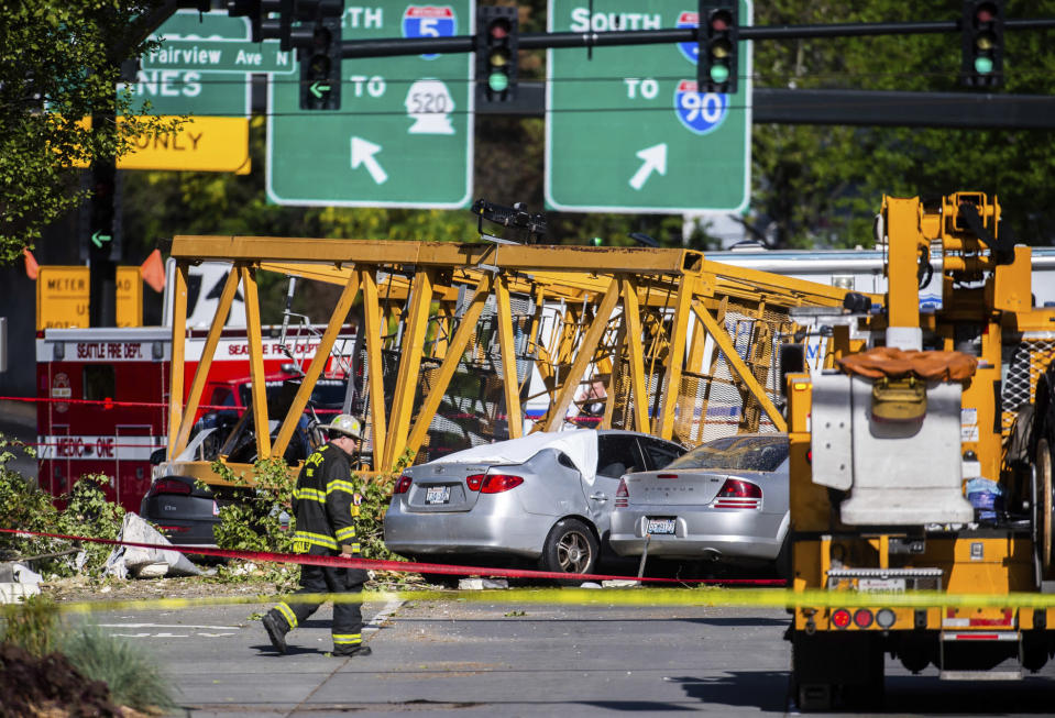 Emergency crews work the scene of a construction crane collapse near the intersection of Mercer Street and Fairview Avenue near Interstate 5 in Seattle, on Saturday, April 27, 2019. The crane was atop an office building under construction in a densely populated area. Authorities say several people have died and a few others are hospitalized after the construction crane fell onto a street in downtown Seattle pinning cars underneath on Saturday afternoon. (Joshua Bessex/The News Tribune via AP)