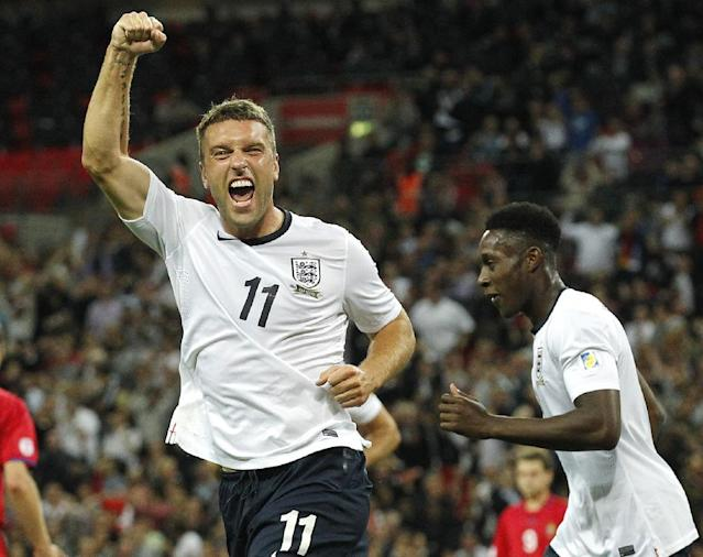 FILE - This is a Friday, Sept. 6, 2013 file photo of England's Rickie Lambert celebrates after scoring a goal during the World Cup group H qualifier soccer match between England and Moldova at Wembley Stadium in London. England striker Rickie Lambert Monday June 2, 2014 joined Liverpool from Southampton for a reported fee of 4 million pounds ($6.7 million), strengthening the team's attacking options ahead of its return to the Champions League. Released by his boyhood club as a 15-year-old, Lambert returns to Anfield after spending most of his career as a journeyman in England's lower leagues before making his name with Southampton since 2009. (AP Photo/Sang Tan, File)