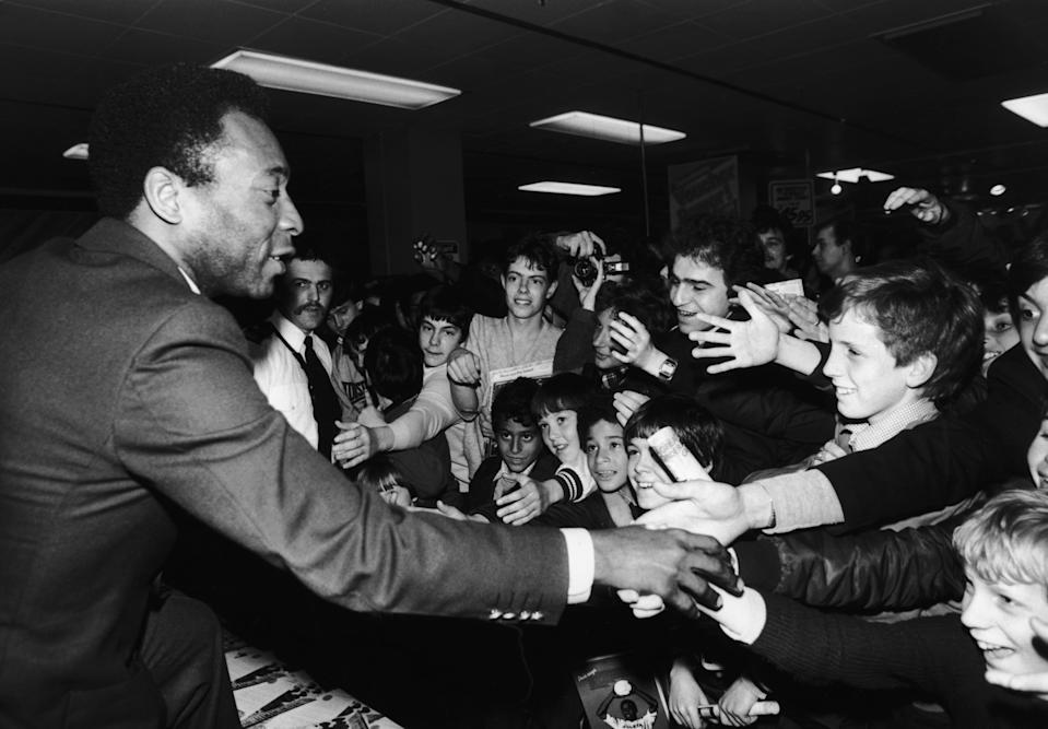 Brazilian footballer Pele greeting fans in the Oxford Street Debenhams store in London, 30th April 1981. (Photo by Ian Tyas/Keystone/Getty Images)